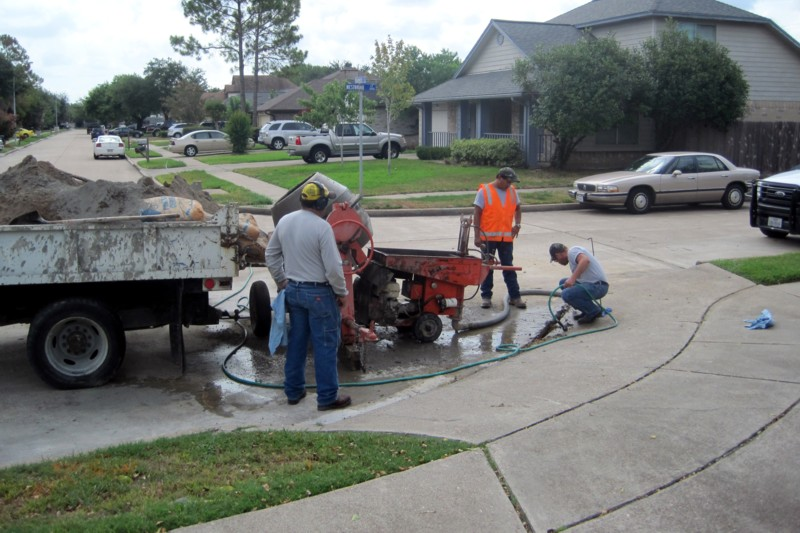 Workers performing maintenance on a street